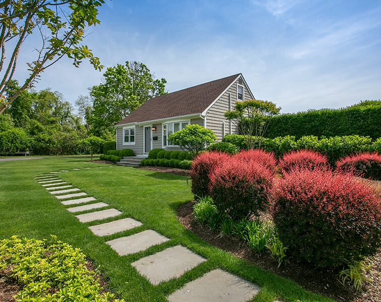 House in landscaped grass with garden